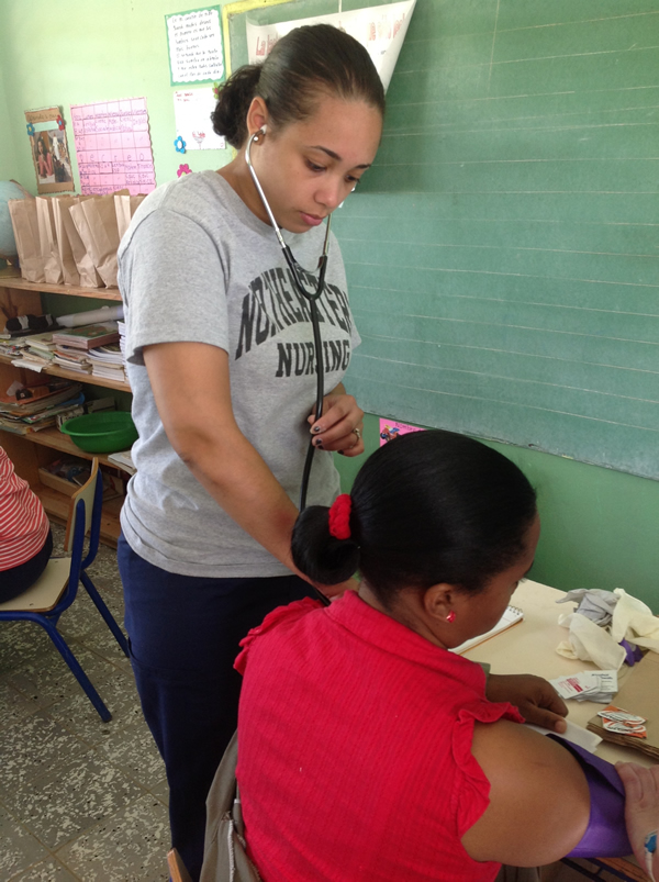Stephanie Mantos diagnosing a child in the Dominican Republic